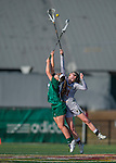 30 March 2016: University of Vermont Catamount Midfielder Brynne Yarranton, a Junior from Toronto, Ontario, jumps high during a second half face-off against Manhattan College Jasper Attacker Stefanie Ranagan, a Senior from Yorktown Heights, NY, at Virtue Field in Burlington, Vermont. The Lady Cats defeated the Jaspers 11-5 in non-conference play. Mandatory Credit: Ed Wolfstein Photo *** RAW (NEF) Image File Available ***