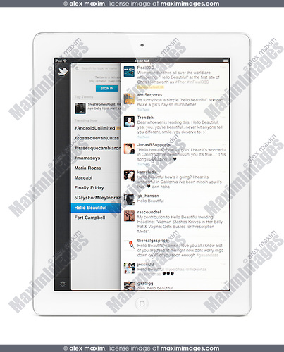 Apple iPad 2 tablet computer with Twitter, social networking service on its display. Isolated with clipping path on white background.