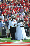 Homecoming Queen Courtney Pearson (right) is escorted by her father Commander Kerry Pearson during halftime of the Mississippi vs. Auburn at Vaught-Hemingway Stadium in Oxford, Miss. on Saturday, October 13, 2012. Miss Pearson is the University of Mississippi's first African-American homecoming queen..