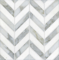 Errol, a stone mosaic, shown in Thassos and Calacatta Tia, is part of the Ann Sacks Beau Monde collection sold exclusively at www.annsacks.com