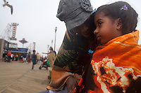 Seaside Heights, NJ - June 30, 2013 :  Aniah Ramos, 3, with her grandmother Benita Thomas, from Orange, NJ, keep warm along the new boardwalk at Seaside Heights, NJ on June 30, 2013. People are returning to the beaches for the summer after recovery efforts post Sandy.