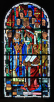 Saint Louis at the consecration of the Church at Poissy, stained glass window, 1939, by Hollart and Provenzano, surrounding the baptismal fonts in the Chapelle Saint Louis in the Collegiale Notre-Dame de Poissy, a catholic parish church founded c. 1016 by Robert the Pious and rebuilt 1130-60 in late Romanesque and early Gothic styles, in Poissy, Yvelines, France. The chapel windows illustrate the baptism, education and coronation of Saint Louis, or King Louis IX of France, born in Poissy in 1214. The Collegiate Church of Our Lady of Poissy was listed as a Historic Monument in 1840. Picture by Manuel Cohen
