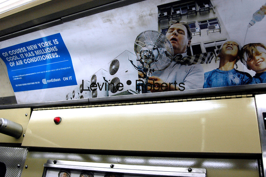 An advertisement for Con Edision, the NYC utility that provides electricity to the majority of the residents, in a subway car on August 4, 2006. During the recent heat wave residents struggled with low power and sporadic black outs because of high demand. (© Richard B. Levine)
