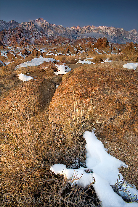 711700276 winter sunrise with snow covered granite boulders in the bureau of land management protected land the alabama hills in the southern section of the eastern sierras with lone pine peak mount whitney and mount russell in the background in kern county california