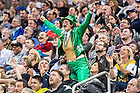 Mar. 21, 2015; A fan dressed in a Leprechaun costume cheers during the third round game of the NCAA Tournament. Notre Dame defeated Butler 67-64 in overtime. (Photo by Matt Cashore/University of Notre Dame)