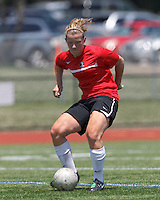 Aztec MA midfielder Caroline Dixon (14) passes the ball. In a Women's Premier Soccer League (WPSL) match, Aztec MA defeated CFC Passion, 4-0, at North Reading High School Stadium on July 1, 2012.
