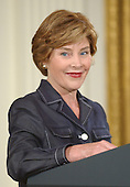 First lady Laura Bush makes remarks at the White House ceremony where the Clinton portraits were unveiled at the White House in Washington, D.C. on June 14, 2004.  .Credit: Ron Sachs / CNP