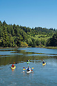 Kayaking on Lint Slough at Waldport on the central Oregon Coast.