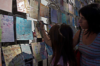 People write on letters for the victims of the last dictatorship during a demonstration led by the 'Madres de Plaza de Mayo'  to commemorate the 37th anniversary of the coup of 1976, at Plaza de Mayo square in Buenos Aires on March 24, 2013. Photo by Juan Gabriel Lopera / VIEWpress.