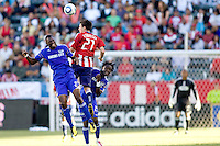 KC Wizards forward Birahim Diop and Chivas USA midfielder Ben Zemanski battle high in the air. The Kansas City Wizards defeated CD Chivas USA 2-0 at Home Depot Center stadium in Carson, California on Sunday September 19, 2010.