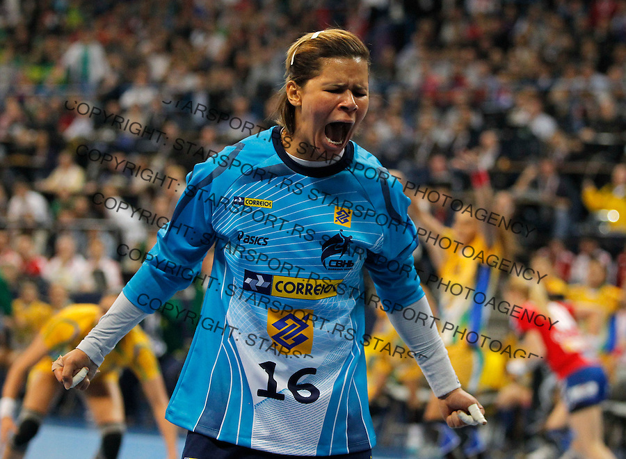 BELGRADE, SERBIA - DECEMBER 22:  Goalkeeper Mayssa Pessoa celebrates their victory after the World Women's Handball Championship 2013 Final match between Brazil and Serbia at Kombank Arena Hall on December 22, 2013 in Belgrade, Serbia. (Photo by Srdjan Stevanovic/Getty Images)