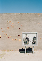 An old sign in the prison yard at Robben Island Museum, depicting Nelson Mandela and Walter Ssulu. Near Cape Town, South Africa