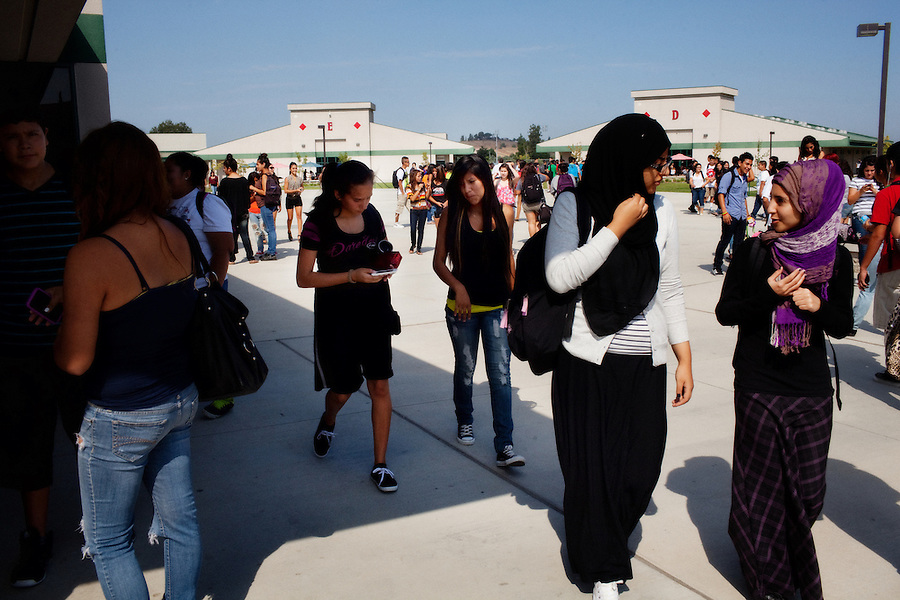 Lindsay, California, September 5, 2012 - Students walk to class at Lindsay High School. The school began building a competency-based education model about 7 years ago, fully implementing it just over three years ago and is set to graduate its first class this school year. This model does away with traditional grading and pass/fail for grades. Instead students are expected to achieve proficiency in a range of areas in each class, where a 3 (equal to a traditional B) is passing; A 4 is considered intensive and usually denotes college bound. Says Principal Jaime Robles, ?This allows students to learn at there own pace. If a student is advanced, they can move ahead, and if a student is lagging, they get the support they need.? Part of this model allows for students who are more advanced dig deeper and push harder and truly move ahead of others. Because they are ahead, some spend the extra time learning more, others take concurrent classes at the nearby community college and some choose to graduate early to start their path. ?Each student has their own set of goals,? says English teacher Amalia Lopez, ?Whatever their goals are, we support them.?.Slug: DD_ CompetencyByline: Daryl Peveto / LUCEO for Education Week
