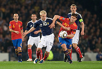 Spanish midfielder Xabi Alonso (R) vies with Scottish forward Steven Naismith during their Euro 2012 qualifying football match at Hampden Park, Glasgow, Scotland on October 12, 2010.Photo by (Ross Gilmore)