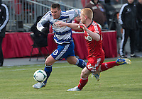 06 April 2013: FC Dallas forward Kenny Cooper #33 battles for a ball with Toronto FC defender Richard Eckersley #27 during an MLS game between FC Dallas and Toronto FC at BMO Field in Toronto, Ontario Canada..The game ended in a 2-2 draw..