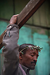 An Orthodox-Ethiopian Christian pilgrim at Deir Al-Sultan, the Ethiopian section of the Church of Holy Sepulchre in Jerusalem's old city, as worshippers gather for the Holy Fire ceremony during Easter. The ancient fire ritual celebrates the Messiah's resurrection after being crucified on the cross.