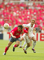 Eddie Lewis battles for the ball. The USA tied South Korea, 1-1, during the FIFA World Cup 2002 in Daegu, Korea.