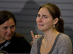 Edda Knox, left, comforts her daughter, Amanda Knox, during a news conference held  at the Seattle-Tacoma International Airport near Seattle, Washington on October 4, 2011. Knox arrived in the United States after departing Rome's Leonardo da Vinci airport,. Knox's life turned around dramatically Monday when an Italian appeals court threw out her conviction in the sexual assault and fatal stabbing of her British roommate.  ©2011. Jim Bryant Photo. All Rights Reserved.
