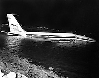 TWA Cargo Boeing 707 over shot the runway at San Francisco International Airport landing in San Francisco Bay. Three crew men aboard no one was injured.<br />