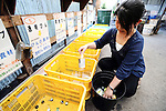 A resident disposes of brown bottles at the waste disposal site in central Kamikatsu Town in Shikoku, Japan. The town, whose residents number just over 2,000 people, has implemented a waste recycling policy that aims at eliminating waste entirely within the next 12 years and employs retired local residents to care for the waste disposal center. Waste must be divided up into 34 categories.