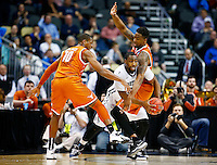 PITTSBURGH, PA - MARCH 19:  Roosevelt Jones #21 of the Butler Bulldogs tries to get past the defense of Cameron Ridley #55 and Jonathan Holmes #10 of the Texas Longhorns in the first half during the second round of the 2015 NCAA Men's Basketball Tournament at Consol Energy Center on March 19, 2015 in Pittsburgh, Pennsylvania.  (Photo by Jared Wickerham/Getty Images)
