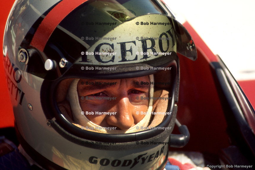 ELKHART LAKE, WI - JULY 27: Mario Andretti waits to drive the Lola T332 HU29/Chevrolet during the USAC/SCCA Formula 5000 event on July 27, 1975, at the Road America circuit near Elkhart Lake, Wisconsin.