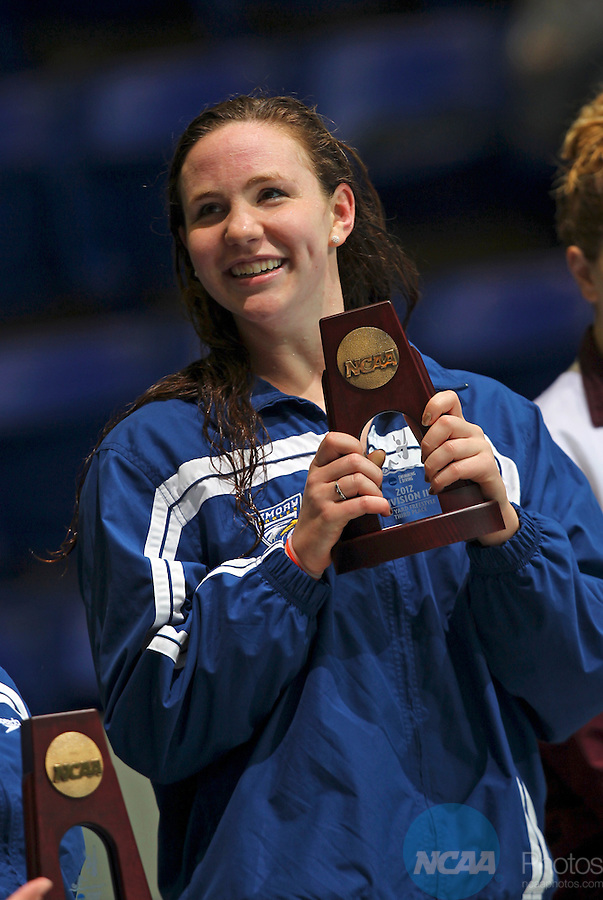 24 MAR 2012:  Third place finisher in the 100 yard freestyle Anna Dobben of Emory holds up her trophy during the Division III Mens and Womens Swimming and Diving Championship held at the IU Natatorium in Indianapolis, IN.  Michael Hickey/NCAA Photos