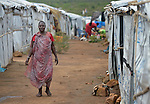 A woman walks inside a United Nations base in Juba, South Sudan, where some 34,000 people have sought protection since violence broke out in December 2013. More than 112,000 people currently live on UN bases in the war-torn country, most of them afraid of tribally targeted violence.