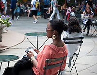 A reader uses her Nook electronic book in Bryant Park in New York on Thursday, June 7, 2012 (© Richard B. Levine)
