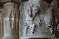 Capital with man carrying object, from the nave of the Basilique Saint Remi or Abbey of St Remi, Reims, France. The 11th century, mainly Romanesque, church, contains the relics of St Remi, the Bishop of Reims, who converted Clovis, the King of the Franks, to Christianity in 496 AD. The abbey is a UNESCO World Heritage Site. Picture by Manuel Cohen