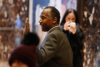 Former Republican presidential  candidate Ben Carson waves to bystanders as he walks through the lobby of the Trump Tower in New York, New York, on November 22, 2016.  United States President-elect Donald Trump has mentioned he is considering Mr. Carson for a cabinet post as the head of the Department of Housing and Urban Development (HUD). <br /> Credit: Anthony Behar / Pool via CNP /MediaPunch