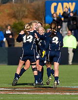 Lauren Fowlkes (9) of Notre Dame celebrates the win after the final of the NCAA Women's College Cup at WakeMed Soccer Park in Cary, NC.  Notre Dame defeated Stanford, 1-0.