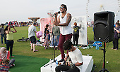 "Rufio Summers (www.rufiosummers.com), singer, performing at ""Showtime"", part of the London 2012 Festival of Arts to celebrate the London Olympics.  A family fun spectacle including dance, painting, music, acrobatics and some large mobile dynosaurs walking amongst the crowd.  On Blackheath Common, Saturday August 4th and funded by the Mayor of London and Arts Council England."