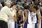 Duke Coach Joanne P. McCallie encourages her team to succeed in the final minutes against Georgia Tech. This game was one of the two Semifinal games of the 2011 ACC Tournament in Greensboro on Saturday, March 5, 2011. Duke beat Georgia Tech 74-66. (Photo by Al Drago)..