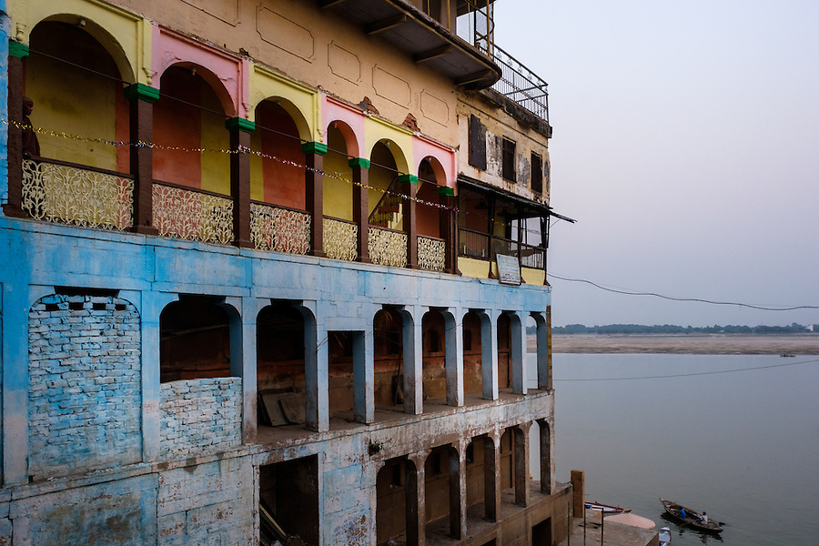 VARANASI, INDIA - CIRCA NOVEMBER 2016: Old building by the Ganges river. The city of Varanasi is the spiritual capital of India, it is the holiest of the seven sacred cities in Hinduism and Jainism. The Ganges is also considered a sacred river.