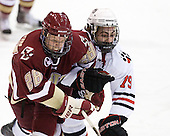 Tommy Atkinson (BC - 28), Cody Ferriero (Northeastern - 79) - The Northeastern University Huskies defeated the visiting Boston College Eagles 2-1 on Saturday, February 19, 2011, at Matthews Arena in Boston, Massachusetts.