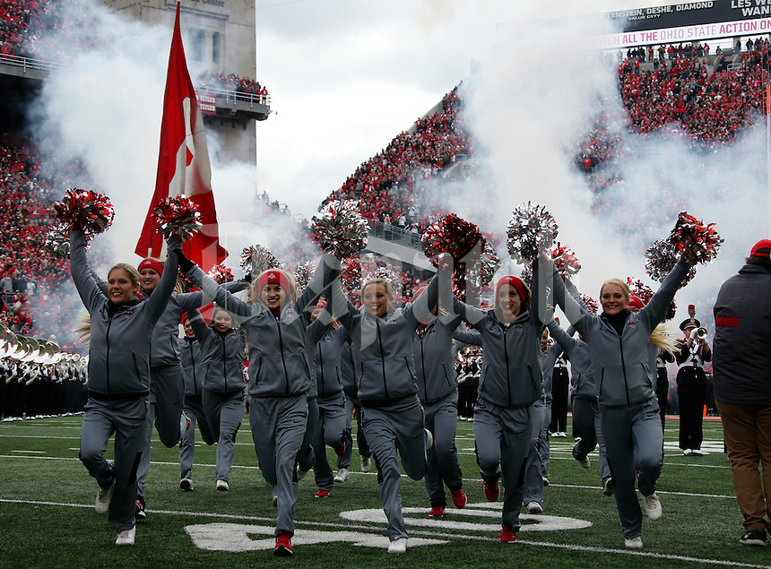 Ohio State cheerleaders take the field before Saturday's NCAA Division I football game against the Michigan Wolverines at Ohio Stadium in Columbus on November 26, 2016. (Barbara J. Perenic/The Columbus Dispatch)