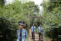 Security guards patrol the Xixi wetlands which lie in the west of the city of Hangzhou. This is China's 'first national wetland park,' dubbed as such to act as a role model to all other wetlands in China and to supposedly show how to effectively manage and restore wetlands, notably urban wetlands. Zhejiang Province. China. 2010