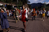 Costumed revelers parade through the street along the Pan American highway as celebrations in bars and small towns continue the week after Day of the Dead. The celebrators stopped buses and trucks asking for money. A cross between Halloween and Day of the Dead, the costumed men were dressed as transvestites, clowns and devils. The party continued for several days.