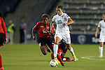 15 October 2014: Carli Lloyd (USA) (10) and Brianna Ryce (TRI) (16). The United States Women's National Team played the Trinidad and Tobago Women's National Team at Sporting Park in Kansas City, Kansas in a 2014 CONCACAF Women's Championship Group A game, which serves as a qualifying tournament for the 2015 FIFA Women's World Cup in Canada. The United States won the game 1-0.