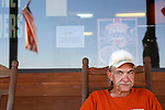 """""""Meds, Exercise diet and sleep. If I don't do all four of those things I get off track, """" said Duane Firestone, 53. """"If I don't take my meds I end up in a jail or hospital."""" Duane sits outside Ot's General Store in Laurel County, Kentucky, on October 24, 2012, looking to hitch a ride to a nearby town. ..Photo by Coty Giannelli"""