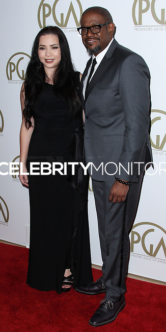BEVERLY HILLS, CA - JANUARY 19: Nina Yang Bongiovi, Forest Whitaker at the 25th Annual Producers Guild Awards held at The Beverly Hilton Hotel on January 19, 2014 in Beverly Hills, California. (Photo by Xavier Collin/Celebrity Monitor)