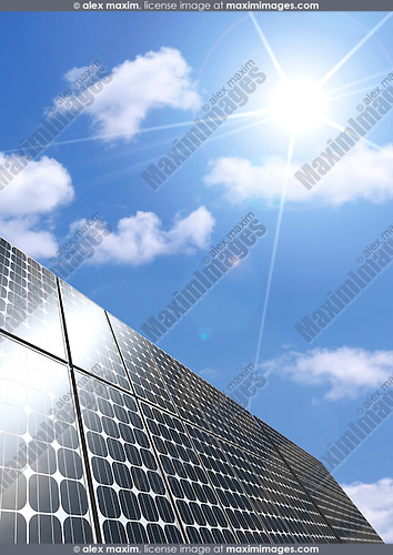 Solar panel under blue sky brightly lit by the sun