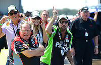 Sept. 22, 2012; Ennis, TX, USA: NHRA John Paul DeJoria (right) and Connie Kalitta watch as funny car driver Alexis DeJoria goes down the track during qualifying for the Fall Nationals at the Texas Motorplex. Mandatory Credit: Mark J. Rebilas-