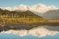 Gillespies Beach with Southern Alps, Mount Tasman and Mount Cook reflecting in Cook River in foreground, Westland National Park, World Heritage Area, West Coast, New Zealand