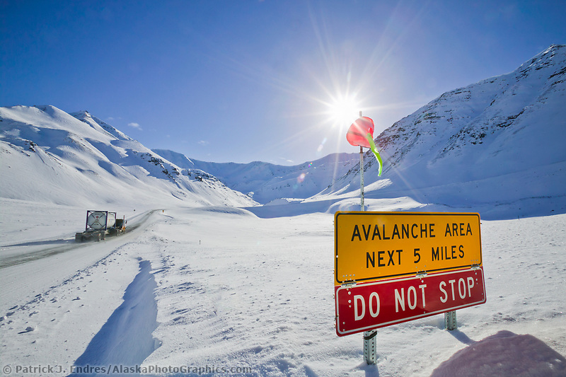 Avalanche sign at the base of Atigun Pass, the highest roadway pass in Alaska, along the James Dalton Highway (Haul Road) in the Brooks mountain range. The Haul road provides access to the Prudhoe Bay oil fields.