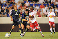 Garreth Bale (3)  of Tottenham Hotspur F. C. and Macoumba Kandji (10) of the New York Red Bulls battle for the ball. Tottenham Hotspur F. C. defeated the New York Red Bulls 2-1 during a Barclays New York Challenge match at Red Bull Arena in Harrison, NJ, on July 22, 2010.
