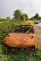 Burnt-out car wreck on roadside, Oxfordshire, United Kingdom