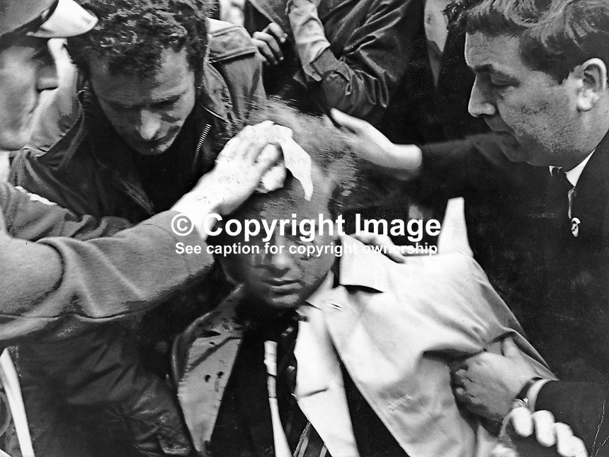 Ivan Cooper, Derry Citizen's Action Committee, DCAC, is tended by John Hume (right) after being injured in clashes which followed an Apprentice Boys of Derry parade in Londonderry on 12th August 1969. Just a year later both John Hume and Ivan Cooper along with Gerry Fitt were founder members of the SDLP, Social Democratic &amp; Labour Party. 1969081201a<br /> <br /> Larry Doherty copyright Image from Victor Patterson, 54 Dorchester Park, Belfast, UK, BT9 6RJ<br /> <br /> t1: +44 28 9066 1296<br /> t2: +44 28 9002 2446<br /> m: +44 7802 353836<br /> <br /> e1: victorpatterson@me.com<br /> e2: victorpatterson@gmail.com<br /> <br /> www.victorpatterson.com<br /> <br /> IMPORTANT: Please see my Terms and Conditions of Use at www.victorpatterson.com