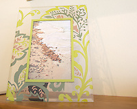 Seaweeds beach picture in a transparent floral pattern glass frame.